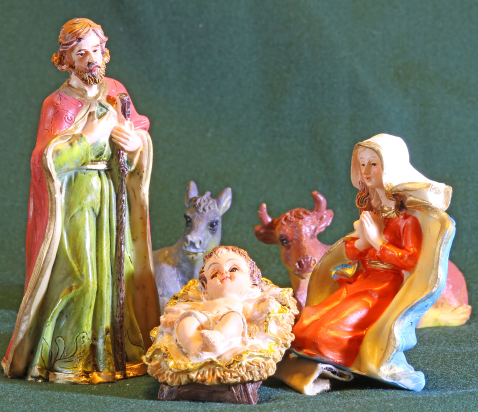 Mary and Joseph with the child Jesus in the Manger of the crib at Christmas